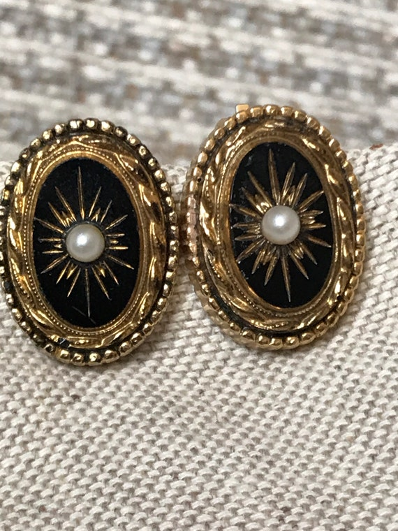 1950s Sphinx Victorian revival style black glass clip on earrings