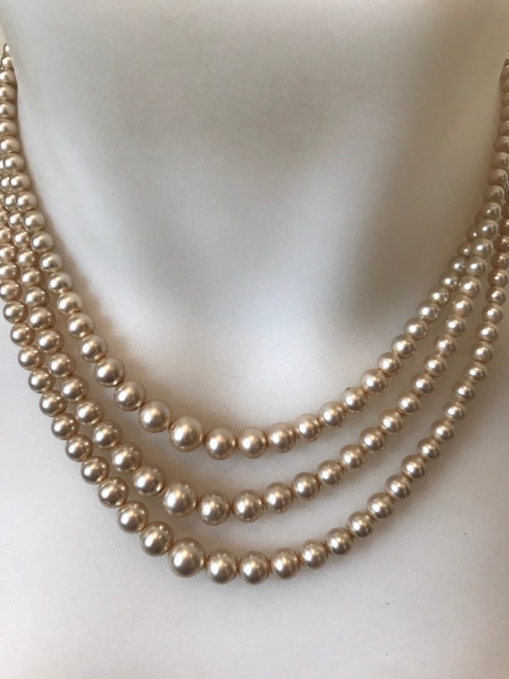 Elegant Vintage three stranded faux pearl necklace with large Marcasite clasp