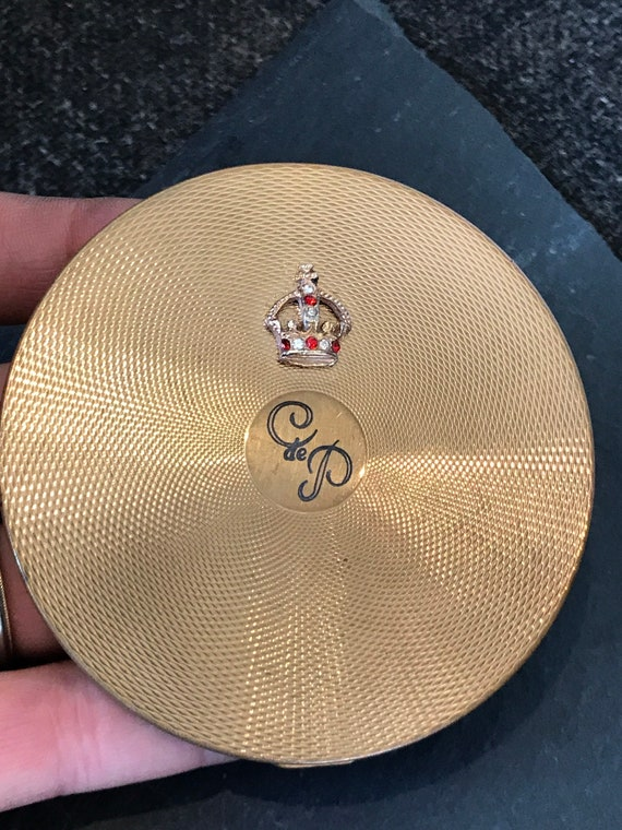 AGME Swiss Made vintage gold tone powder compact with jewelled crown monogrammed logo Vintage compact powder vanity mirror