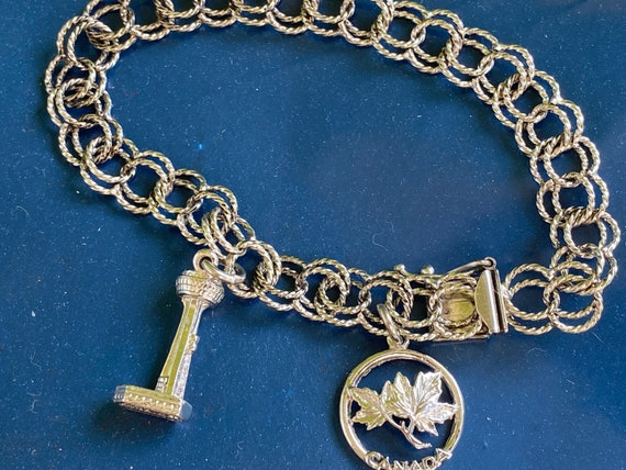 Vintage Canadian Sterling Silver charm bracelet with maple leaf charm and Niagara Falls charms