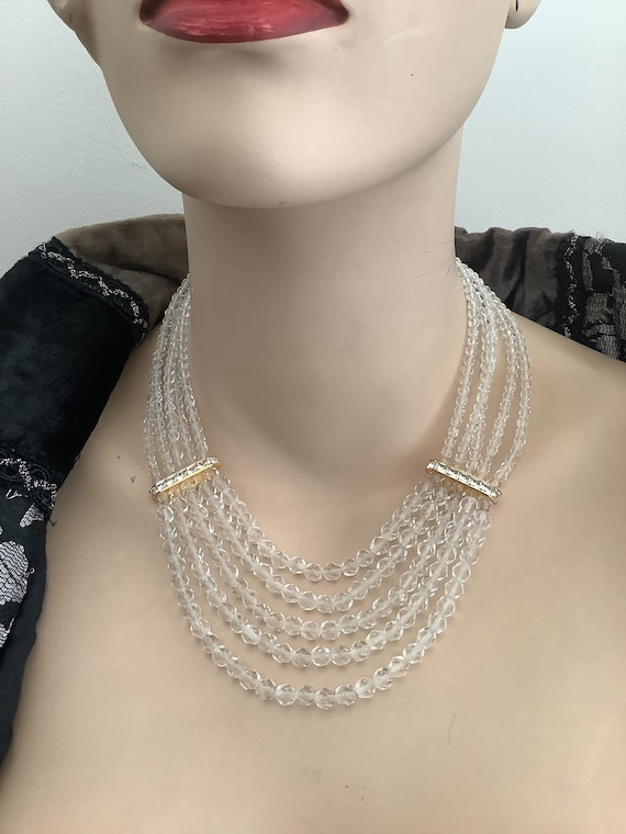 Multi stranded Monet crystal beaded necklace with gold plated diamanté accents