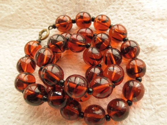 A striking Vintage Czech Honey Amber glass beaded necklace.