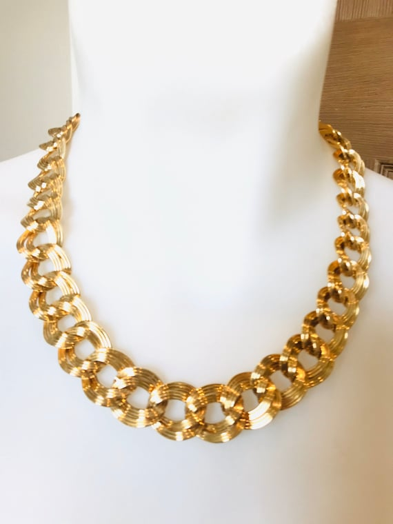 Beautiful chunky gold toned vintage necklace and matching bracelet by MONET