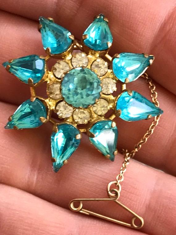 Vintage 1950s turquoise rhinestone starburst flower brooch
