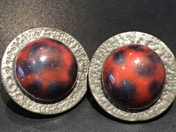 Vintage Ruskin style pewter clip on earrings with a Center deep red glass cabochons