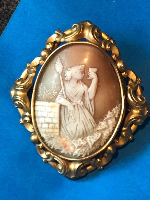 Large Victorian real shell cameo in elaborate pinchbeck framed brooch pin with safety chain