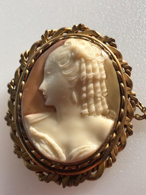 Antique/ Vintage celluloid cameo brooch in ornate gold filled frame
