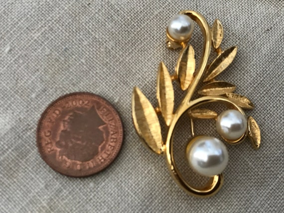 Striking faux pearl and goldstone statement piece brooch by designers Napier