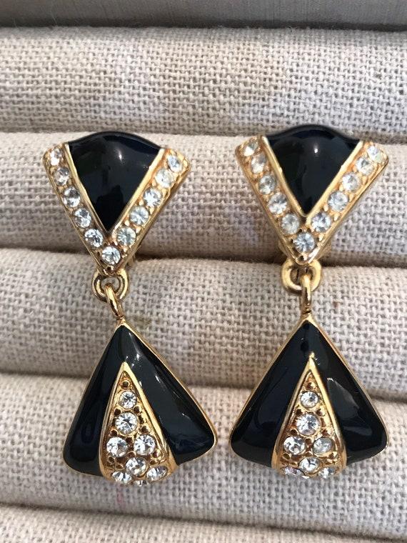 Vintage black enamel and gold tone drop clip on  earrings by MONET