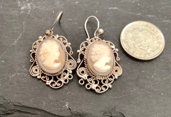 A Pair of vintage filigree silver and real carved cameo pierced drop hook earrings