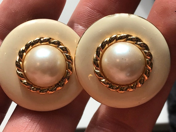 A beautiful pair of enamelled faux pearl signed vintage clip-on earrings by makers MONET