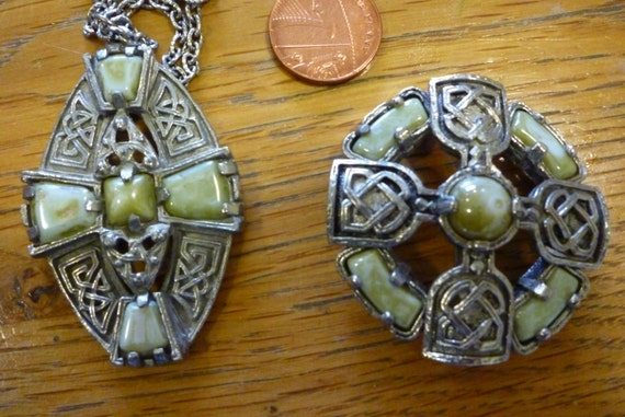 A striking Celtic style vintage pendant necklace and matching brooch in faux green agate