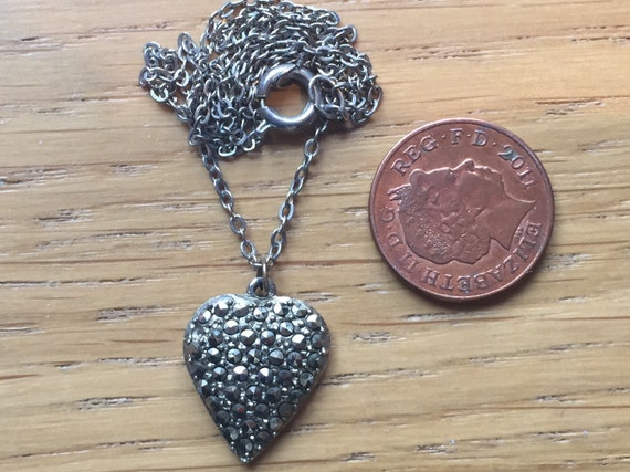A vintage marcasite heart shaped pendant and chain