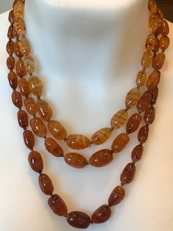 beautiful three stranded vintage Amber and gold glass beaded necklace circa 1950s