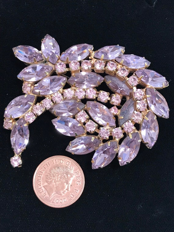 Stunning vintage pink and purple rhinestone statement brooch by Kramer