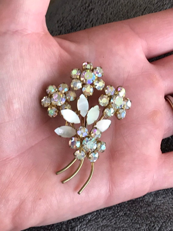 Sparkling 1950s white rhinestone and mother of pearl floral bouquet brooch