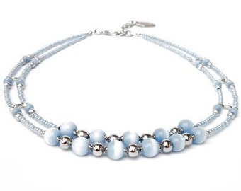Short blue necklace with ice blue tiger eye beads and seed beads. Handcrafted choker, silver-colored beads, dividers, cat's eye bead jewelry