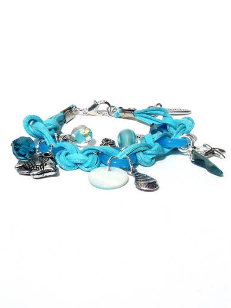 Aquamarine bracelet with charms shell mother-of-pearl. image 0