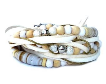 Wrap bracelet with beige and white beads. Handcrafted wristlet, faux suede cord, wax cord, triple wrap wristband, wooden bead, ceramic glass