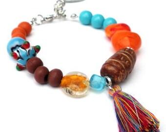 Tassel bracelet, ceramic beads, glass beads, wooden beads in aquamarine, brown and orange. Handcrafted wristband, beads, tassel, boho chic