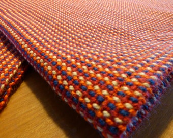 100% cotton handwoven dishcloth.Red, orange, yellow and blue linen. Hand woven on traditional loom