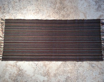 Hand-woven rectangular table runner (multicolor) . Weaving with fringes and stripes. Table setting, home decoration