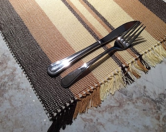 Set of 6 hand-woven rectangular placemats, brown and yellow . Weaving with fringes and stripes. Set of table for lunch, home decoration