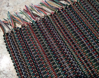 Set of 6 hand-woven rectangular placemats (multicolor). Weaving with fringes and stripes. Set of table for lunch, home decoration