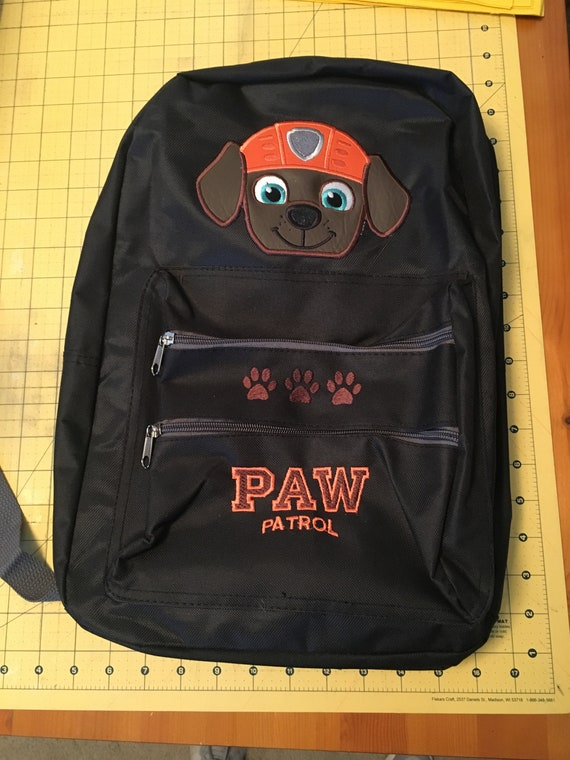 Black backpack school bag with an embroidered diver pup on it.