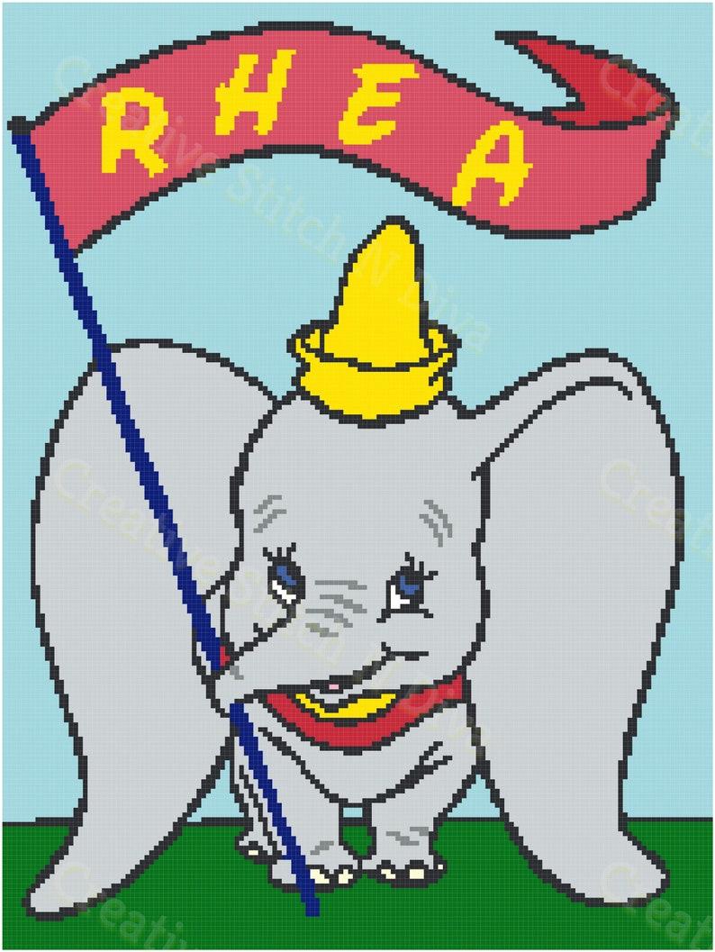 Dumbo holding a Flag