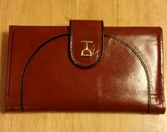 Vintage bifold reddish brown Baronet ladies wallet.