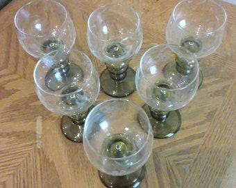 Green stemmed wine glasses