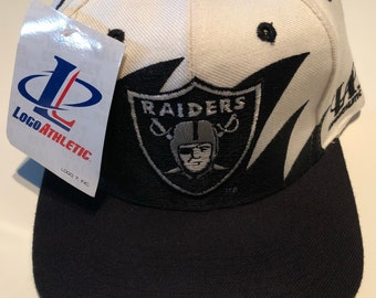 e1fe4eec5ca Deadstock New Nwt Vintage Nfl Football Oakland Los Angeles Raiders Logo  Athletic Shark Tooth Splash Snapback Hat Cap Super Bowl Deadstock