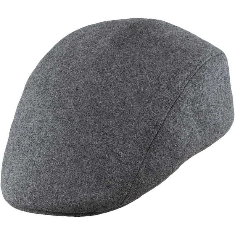 5c05484a52faa NORTE gorra plana con orejera de lana gris
