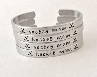 Hockey mom bracelet with childs number on end of cuff, hockey team, hockey player , player, coach, mom, hockey sticks