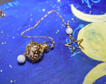 Magikal Wiccan 16mm Moonstone pendulum in gold tone cage, chain and star. Moonstone beads adorn it. Blessed and charged w/positive energy.
