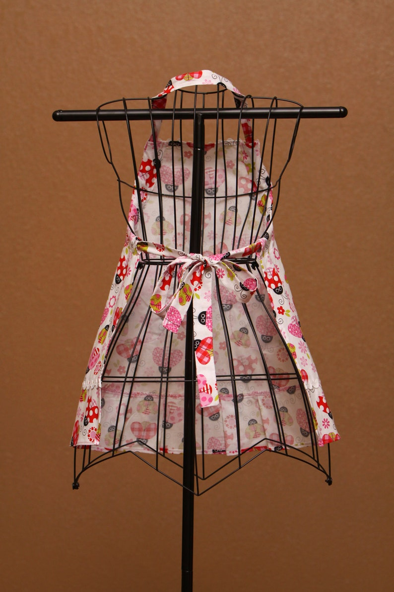 Colorful Ladybugs with Pink Trim on White Background Childrens Apron