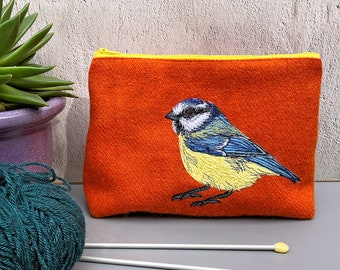 Orange Harris Tweed project bag with embroidered Blue Tit