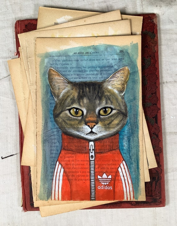 Tiger, portrait of tabby cat in tracksuit original watercolor painting on old book page by Eva Fialka