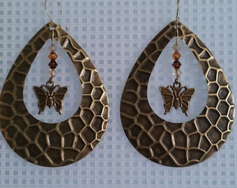 Tear drop metal earrings with metal butterfly accented with swarovski crystals
