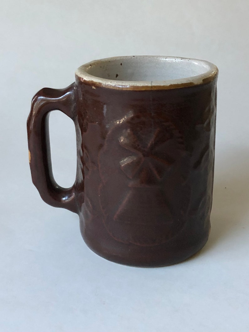 Antique Burley and Winter pottery Thunder mug with windmill and man smoking  a pipe on sides