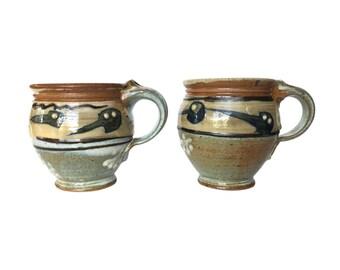 Vintage pair of stoneware pottery mugs