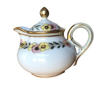 Vintage small porcelain floral hand painted tea pot, creamer