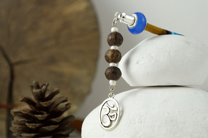 wooden beads and an Om charm Earthy clip in hair braid accessory with blue bead capped end