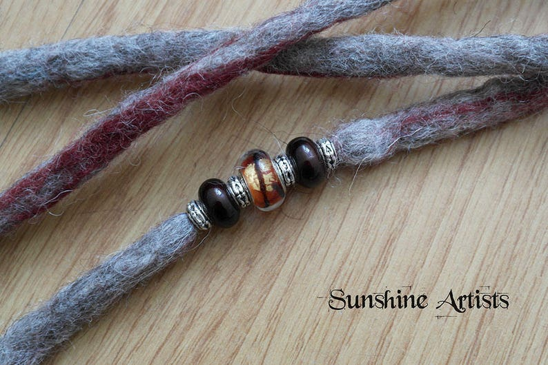 Light grey dreads Tibetan silver clip in extensions bird lover Merino wool birdcage charm burgundy highlights tiger eye glass bead