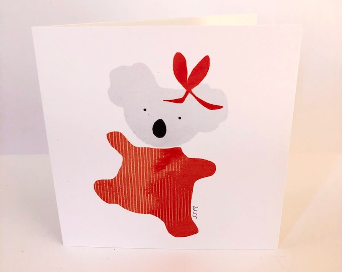 Dancing koala with bow, greeting card