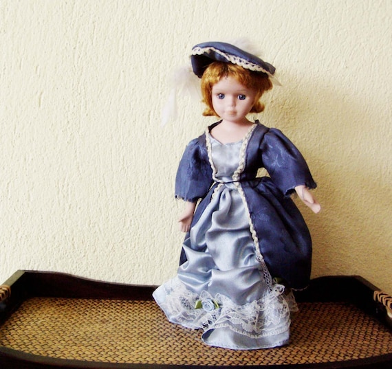 Vintage doll in blue dress, vintage, red haired doll in satin dress, satin overcoat with lace and hat, doll with metal stand, mid seventies
