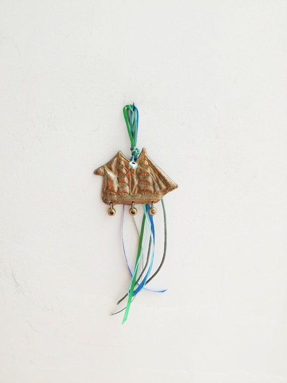 Brass boat lucky charm, vintage brass keepsake of Greek, retro galleon with ribbons, beads and blue eye, classic boat Greek brass charm