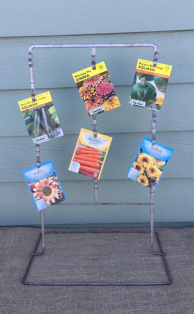 Metal display rack clip up hook hooks craft show vintage sale stamped card jewelry hanger upright vertical garden shed seed packet chips
