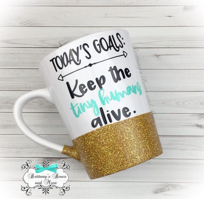 Todays goal keep the tiny humans alive  Glittered Coffee Mug image 0